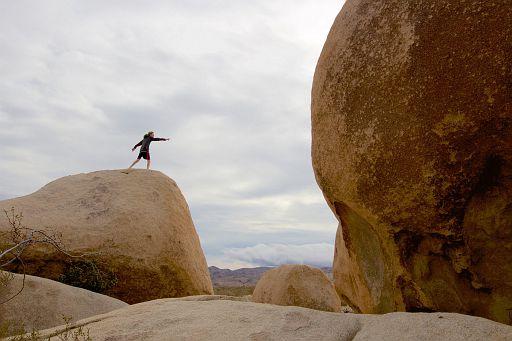 pointing at the bigger rock