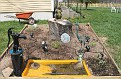 Dana fixed up a small water pump for Nats flower bed.