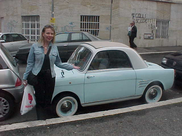 Susana at a cute little car.